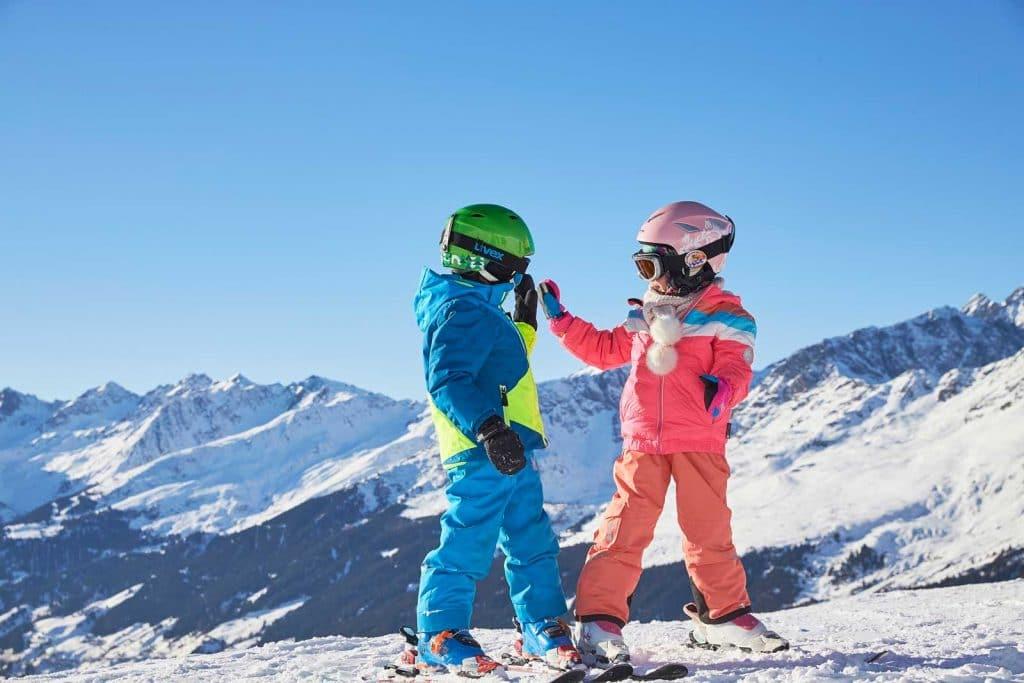 Two children on ski slopes at Paznaun-Ischgl