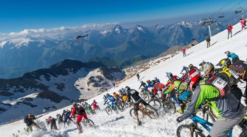 Mountain bikers tackling the ski slopes in Megavalanche