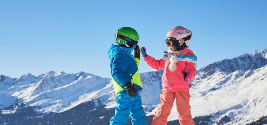 Two children on ski slopes at Paznaun-Ischgl